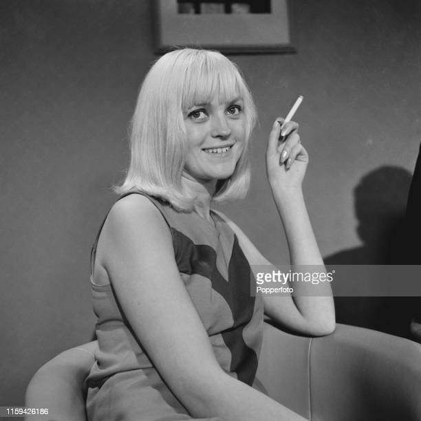 English radio presenter Annie Nightingale pictured smoking a cigarette in July 1965