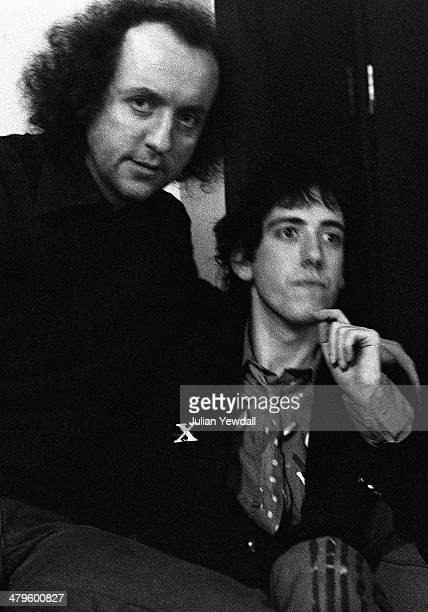 English record producer and manager Guy Stevens and guitarist Mick Jones of British punk group The Clash, backstage at a concert at the Royal College...