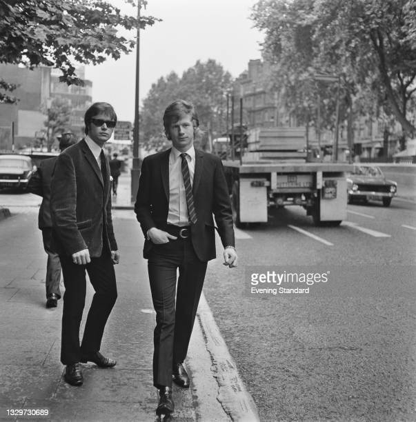 English record producer Andrew Loog Oldham , manager of the Rolling Stones, with his chauffeur and bodyguard Reg 'The Butcher' King , UK, 23rd June...