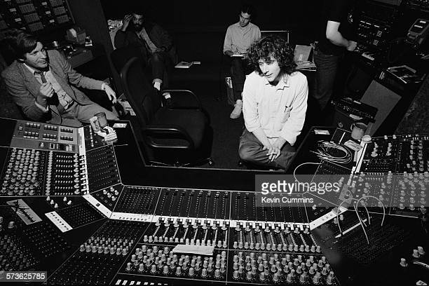 English record producer Martin Hannett in a recording studio, circa 1980. With him are Factory Records founders Tony Wilson and Alan Erasmus .