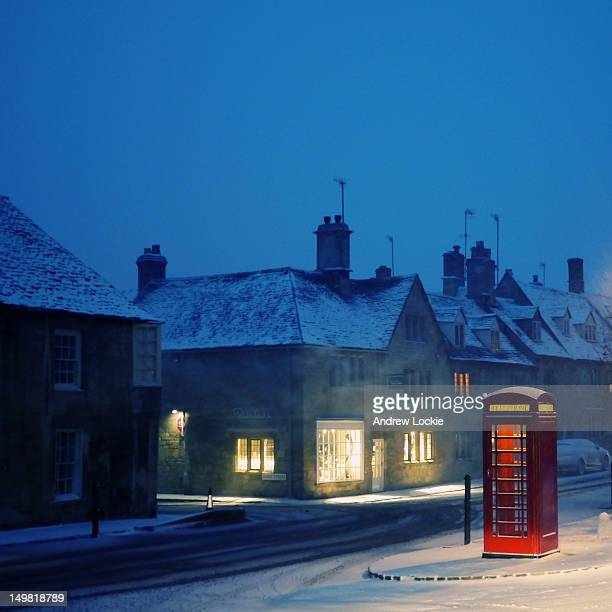 english red telephone booth, in snow - red telephone box stock pictures, royalty-free photos & images