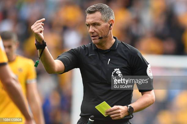 English referee Andre Marriner gestures during the English Premier League football match between Wolverhampton Wanderers and Burnley at the Molineux...