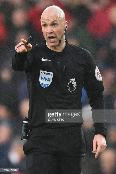 English referee Anthony Taylor gestures during the English Premier League football match between Southampton and Stoke City at St Mary's Stadium in...