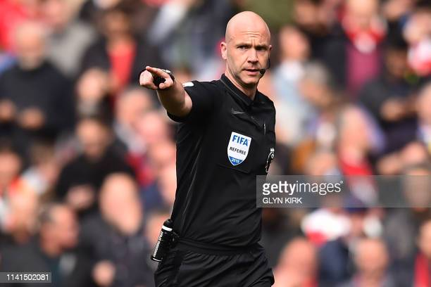 English referee Anthony Taylor indicates a penalty for Arsenal during the English Premier League football match between Arsenal and Brighton and Hove...