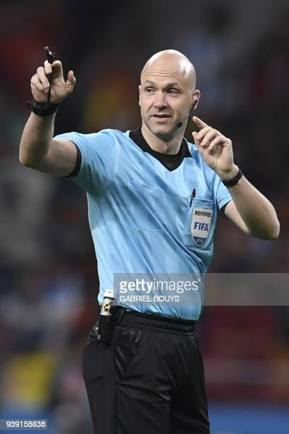 English referee Anthony Taylor officiates a friendly football match between Spain and Argentina at the Wanda Metropolitano Stadium in Madrid on March...