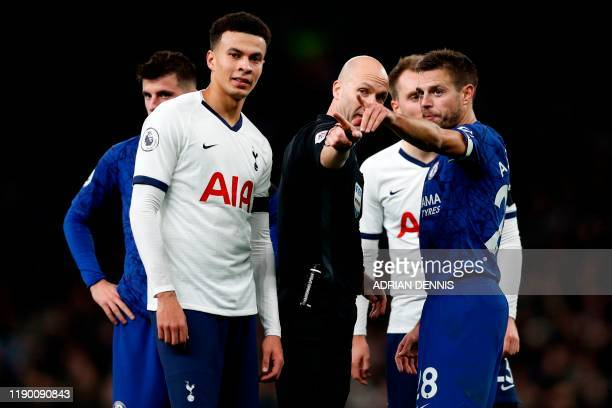 English referee Anthony Taylor points out to players where comments and objects are coming from in the crowd during the English Premier League...