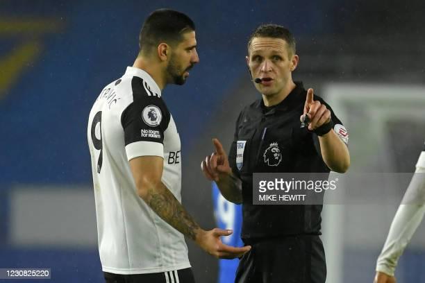 English referee Craig Pawson speaks with Fulham's Serbian striker Aleksandar Mitrovic during the English Premier League football match between...