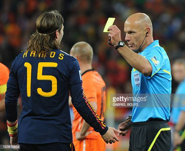Image result for howard webb giving yellow card