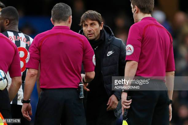 English referee Kevin Friend chats with Chelsea's Italian head coach Antonio Conte on the pitch after the English FA Cup fourth round football match...