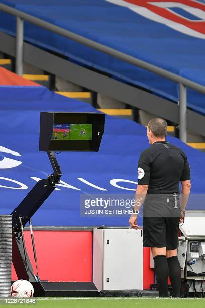 English referee Kevin Friend checks the screen during the English Premier League football match between Crystal Palace and Everton at Selhurst Park...