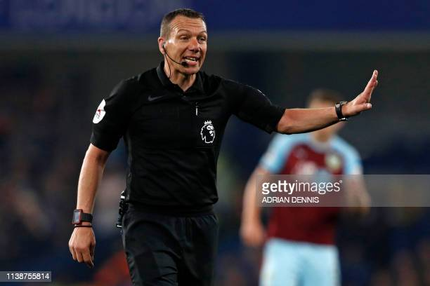 English referee Kevin Friend gestures during the English Premier League football match between Chelsea and Burnley at Stamford Bridge in London on...
