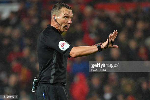 English referee Kevin Friend gestures during the English Premier League football match between Manchester United and Arsenal at Old Trafford in...