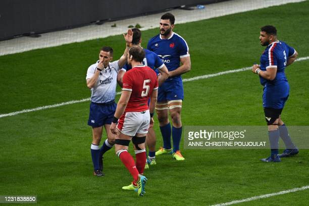 English referee Luke Pearce signals a try for Wales during the Six Nations rugby union tournament match between France and Wales on March 20 at the...