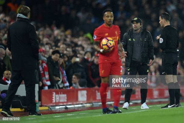 English referee Mark Clattenburg intervenes as Chelsea's Italian head coach Antonio Conte remonstrates with Liverpool's German manager Jurgen Klopp...