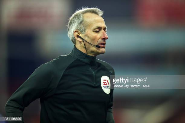 English Referee Martin Atkinson during The Emirates FA Cup Fifth Round match between Barnsley and Chelsea at Oakwell Stadium on February 11, 2021 in...