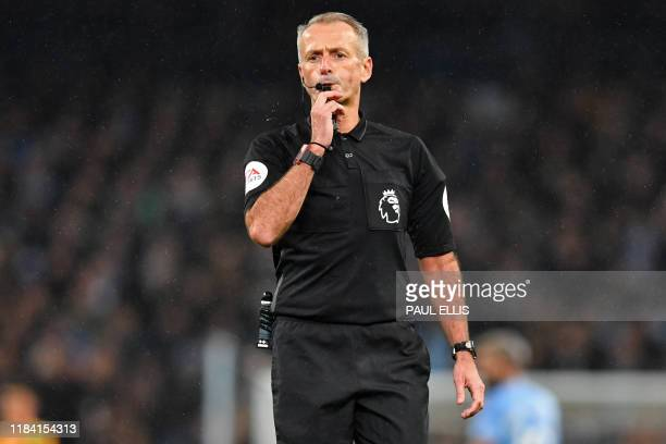 English referee Martin Atkinson whistles during the English Premier League football match between Manchester City and Chelsea at the Etihad Stadium...