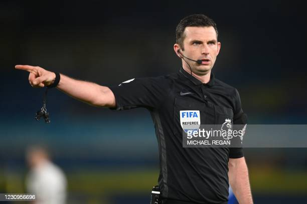 English referee Michael Oliver gestures during the English Premier League football match between Leeds United and Everton at Elland Road in Leeds,...