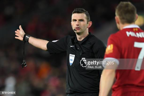 English referee Michael Oliver gestures during the English Premier League football match between Liverpool and Chelsea at Anfield in Liverpool north...