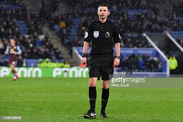 English referee Michael Oliver in the rain during the English Premier League football match between Leicester City and Aston Villa at King Power...