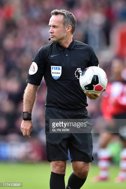 English referee Paul Tierney holds the ball during the English Premier League football match between Southampton and Chelsea at St Mary's Stadium in...