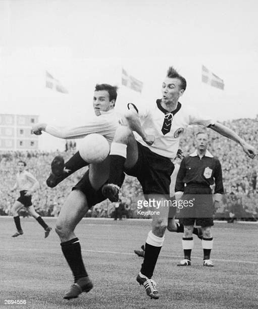 English referee Reg Leafe watching the Argentinian footballer Angel Labruna in a tussle with the German footballer Georg Stollenwerk during a World...