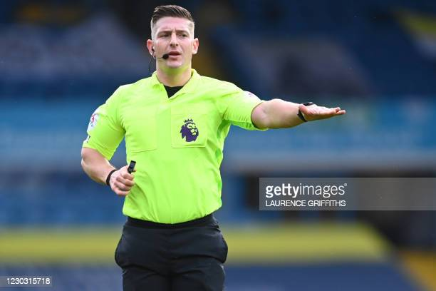English referee Robert Jones gestures during the English Premier League football match between Leeds United and Burnley at Elland Road in Leeds,...