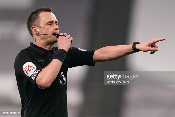 English referee Stuart Attwell blows his whistle during the English Premier League football match between Tottenham Hotspur and Crystal Palace at...