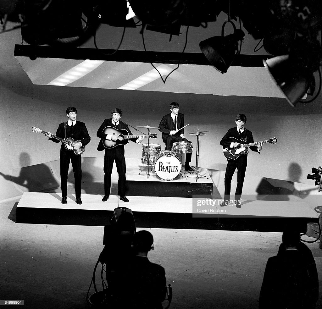 Photo of BEATLES; Paul McCartney, John Lennon, Ringo Starr & George Harrison performing