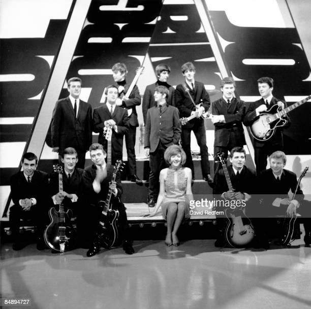 English rock and pop group The Beatles posed together with Cilla Black, The Searchers and Billy J Kramer with the Dakotas on stage during rehearsals...