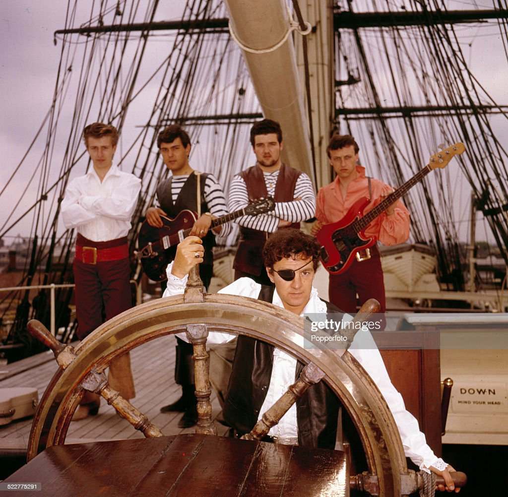 English rock and roll group Johnny Kidd & the Pirates posed on the Cutty Sark ship in Greenwich, London in 1964. From left to right: Vic Cooper, Mick Green, Frank Farley, Johnny Kidd and Johnny Spence.