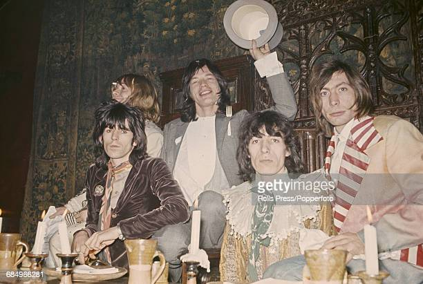 English rock and roll group Rolling Stones posed together in the Elizabethan room at the Kensington Gore Hotel to host a banquet to promote the...