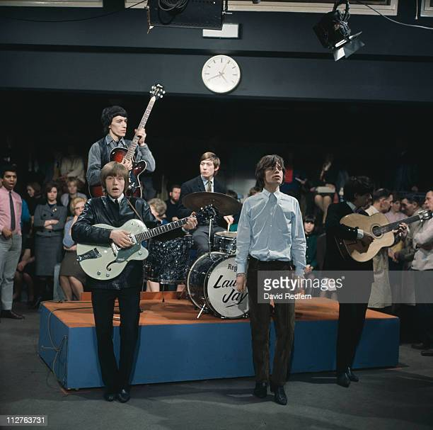 The Rolling Stones guitarist Brian Jones bassist Bill Wyman drummer Charlie Watts singer Mick Jagger and guitarist Keith Richards performing on the...