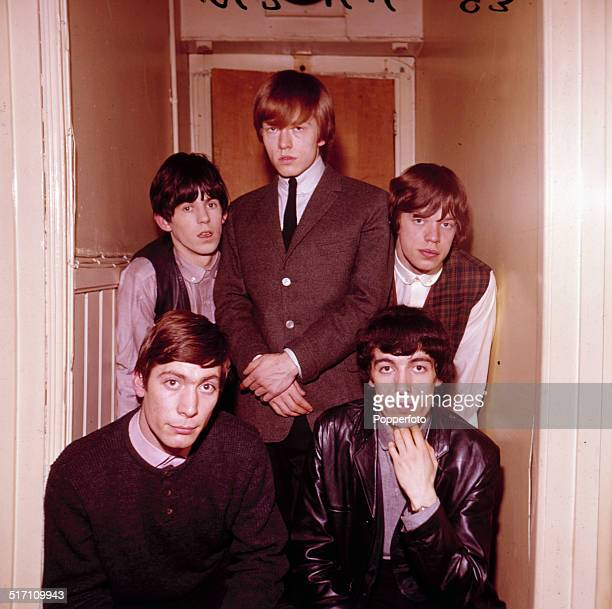 English rock and roll group The Rolling Stones in a doorway in 1963 Clockwise from bottom left Charlie Watts Keith Richards Brian Jones Mick Jagger...