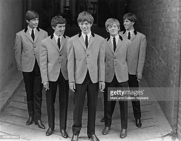 English rock and roll group The Rolling Stones posed wearing matching houndstooth check jackets and dark grey trousers circa 1963 From left to right...