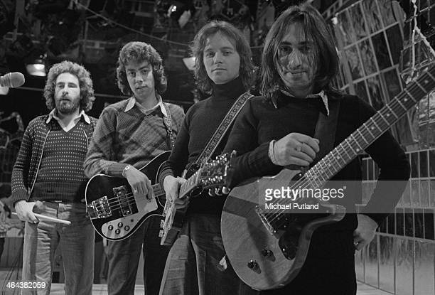 English rock band 10cc during the recording of the Christmas Day edition of the BBC TV music show 'Top Of The Pops' broadcast 25th December 1973 left...
