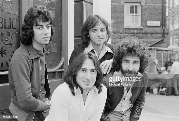English rock band 10cc outside a pub 21st May 1974 Left to right Graham Gouldman Lol Creme Eric Stewart and Kevin Godley