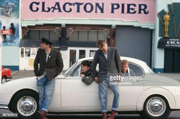 English rock band Blur pose by Clacton Pier in ClactononSea Essex March 1993 Left to right guitarist Graham Coxon bassist Alex James singer Damon...