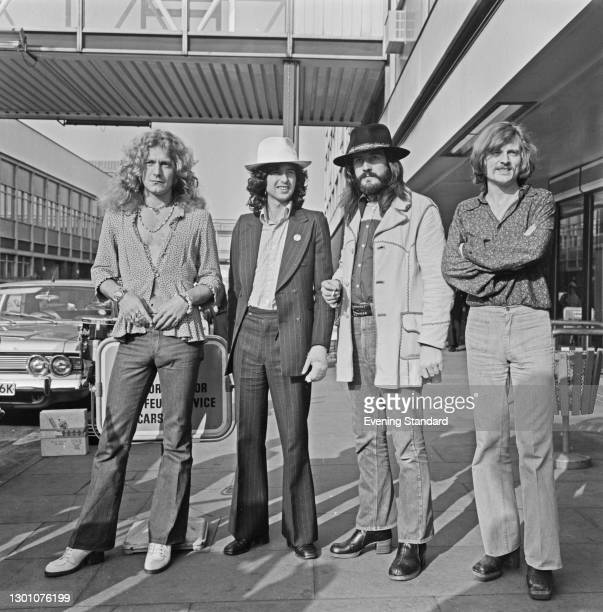 English rock band Led Zeppelin at Heathrow Airport in London, UK, 11th June 1973. From left to right, they are singer Robert Plant, guitarist Jimmy...
