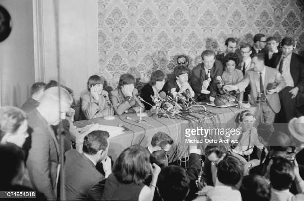 English rock band the Beatles during a press conference in New York City 1964 From left to right Ringo Starr John Lennon George Harrison and Paul...