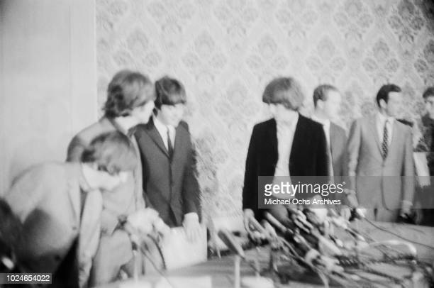 English rock band the Beatles during a press conference in New York City 1964 From left to right Ringo Starr John Lennon Paul McCartney and George...