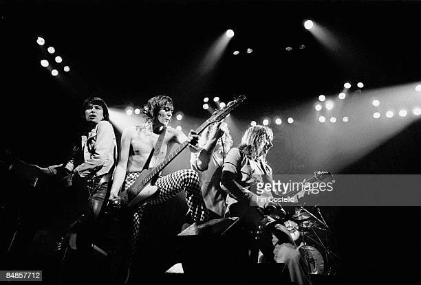 English Rock band UFO perform live on stage in Oxford England in January 1980 Left to right Keyboard player Paul Raymond bassist Pete Way singer Phil...