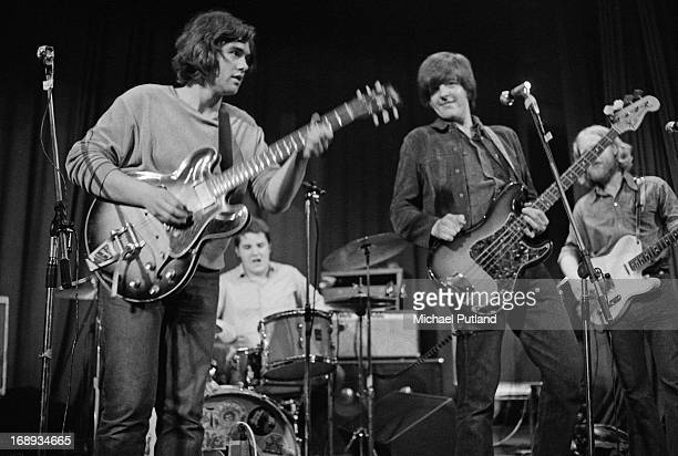 English rock group Brinsley Schwarz performing on stage 4th May 1973 Left to right Brinsley Schwarz Billy Rankin Nick Lowe and Ian Gomm
