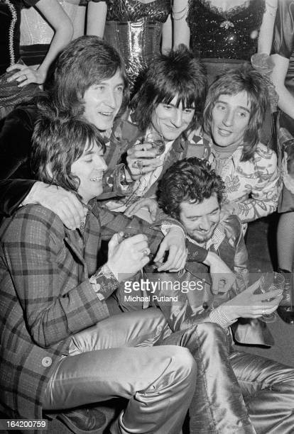 English rock group Faces at a reception at the Tramp nightclub in London for the release of their album 'Ooh La La' 5th April 1973 Clockwise from...