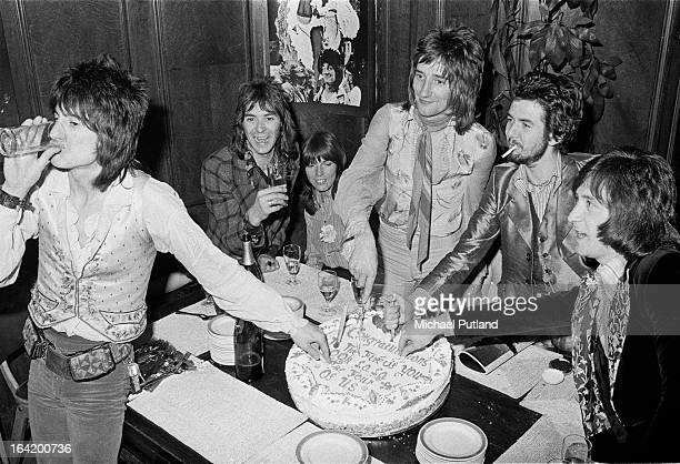 English rock group Faces cutting a cake at a reception at the Tramp nightclub in London for the release of their album 'Ooh La La', 5th April 1973....