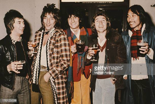 English rock group Faces, London, 1974. Left to right: keyboard player Ian McLagan, singer Rod Stewart, guitarist Ronnie Wood, drummer Kenney Jones...