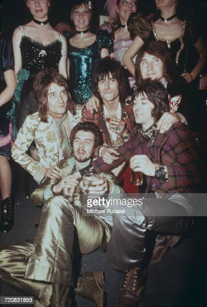 English rock group Faces with a group of showgirls at a reception at the Tramp nightclub in London for the release of their album 'Ooh La La' 5th...