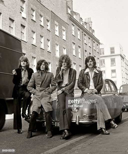 Photo of LED ZEPPELIN posed on a Jaguar car in a London street in December 1968 Left to right John Paul Jones Jimmy Page Robert Plant and John Bonham