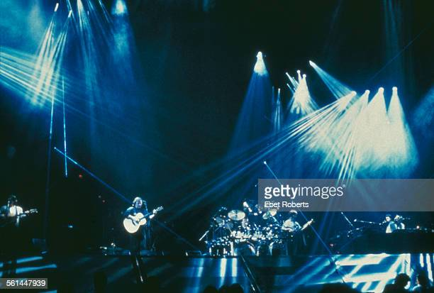English rock group Pink Floyd performing on the A Momentary Lapse of Reason Tour 1987 Guitarist David Gilmour is playing an acoustic guitar centre...