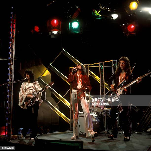 POPS Photo of QUEEN and Freddie MERCURY and John DEACON and Brian MAY LR Brian May Freddie Mercury and John Deacon performing on tv show