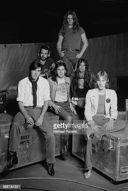 English rock group Roxy Music posing with tour equipment UK 26th September 1975 Left to right singer Bryan Ferry guitarist Phil Manzanera saxophonist...